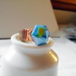 blue faceted hexagon ring with copper wire wraps